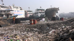 Dhaka, Bangladesh, garbage dump at the shores of the Buriganga river Stock Footage