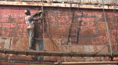 Welder at work at shipyard, wearing little protective gear, Dhaka Bangladesh Stock Footage