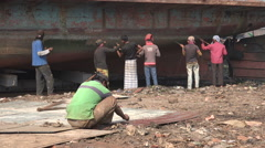 Bangladesh Dhaka, manual labor, shipyard, working conditions, poverty - stock footage