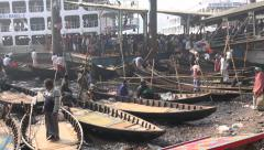 Bangladesh Dhaka, a ferry vessel arrives, boatmen wait for customers Stock Footage