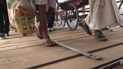 Dhaka, Bangladesh, arriving ferry passengers on gang-way, feet and legs Stock Footage