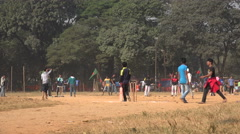 Young men play cricket in a park in Dhaka Bangladesh Stock Footage