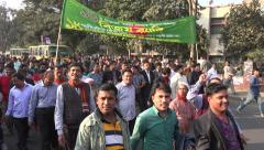Bangladesh Victory Day, politicians and followers walk through Dhaka streets - stock footage