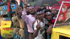 People celebrate Victory Day in Dhaka, Bangladesh, peace sign Stock Footage
