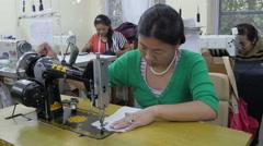 Tibetan refugees sewing garment in Norbulingka Institute in Dharamsala, India Stock Footage