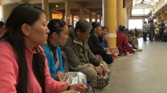 Devotees listen to a speech by the Dalai Lama in McLeod Ganj, India Stock Footage