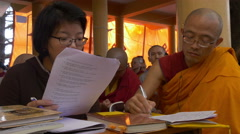 Translating a speech by the Dalai Lama (Chinese language) - stock footage