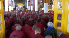 Dalai Lama speech, Buddhist monks, Tibetan culture, television screen, India Stock Footage