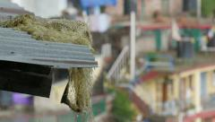 Rain falls on the roof of a building in McLeod Ganj, India Stock Footage
