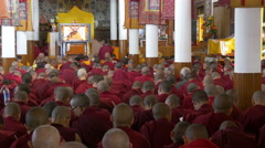 Monks follow Dalai Lama teachings via a screen in McLeod Ganj, India Stock Footage