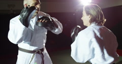 Two athletes in a kimono practicing self defense techniques in slow motion. Stock Footage