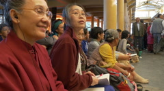 India, McLeod Ganj, Dalai Lama Teachings, devotees listening and laughing Stock Footage