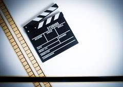 35mm movie filmstrip with clapper board, vintage color, horizontal - stock photo