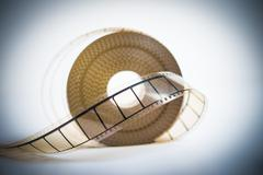 35mm movie reel with selective focus on film vintage color look - stock photo