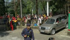Dalai Lama drives home after public teachings, security guards, McLeod Ganj Stock Footage