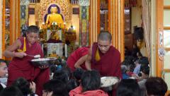 Dalai Lama public speech, young monks hand out food, McLeod Ganj, India Stock Footage