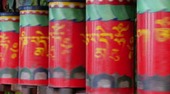 Turning Tibetan prayer wheels in McLeod Ganj, India Stock Footage