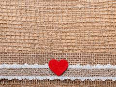 Red heart on abstract cloth background - stock photo