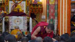 Dalai Lama public teachings, young monk hands out food, McLeod Ganj, India Stock Footage