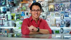 Chinese Man Working As Clerk Sale Assistant In Computer Shop Stock Footage