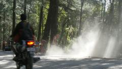 India infrastructure, road workers cleaning dusty path before it is paved Stock Footage