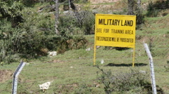 Military land, army training ground, trespassing forbidden, India Stock Footage