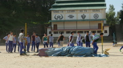 Students at high jump at Tibetan school in Dharamsala, India Stock Footage