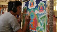 Modern artist paints traditional Tibetan thangka painting in Dharamsala, India Stock Footage