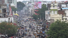 Traffic drives through a busy street in Hyderabad, India Stock Footage