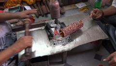 Producing handmade Indian bangles (bracelets) in a traditional workshop - stock footage