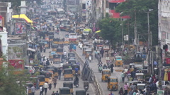 Traffic drives through a busy street during rush hour in Hyderabad, India Stock Footage
