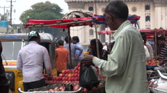 Roadside fruit market at the Charminar in Hyderabad Stock Footage