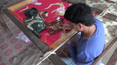 Tailor producing a traditional Indian dress (sari) in a workshop Stock Footage