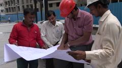 India engineering, construction site, discussing plan, architect,  building Stock Footage