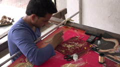 Stock Video Footage of Sari making workshop, colorful dress, craftsmanship, tailor at work, India
