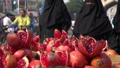 India, Hyderabad city fruit market veiled Muslim women covered burqa Islam - stock footage