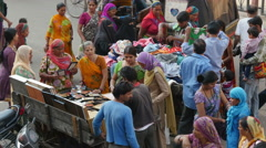India shopping, colorful dress, women, Muslims, Hindus, together Stock Footage