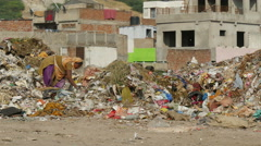 Stock Video Footage of India, a woman works at a garbage dump, urban setting, social issue