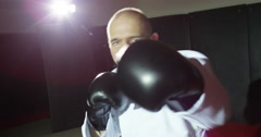 An instructor shadow boxing in slow motion. - stock footage