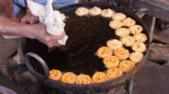 India, preparing jalebi, a popular sweet in South Asia, street food Stock Footage