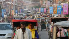 Traffic drives through a busy commercial street in Jaipur city, India Stock Footage