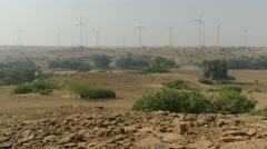 Wind turbines in desert, renewable energy in India Stock Footage