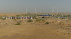 India, wind farm and petrol station in Rajasthan deserts Stock Footage