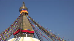 Nepal religion, all seeing eyes of the Buddha, golden tower of Boudhanath stupa Stock Footage