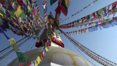 Swaying prayer flags, Buddhist stupa, Tibetan culture, Kathmandu, Nepal religion Stock Footage