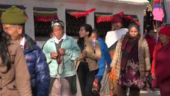 Pilgrims walk circuit around Buddhist stupa in Kathmandu, Nepal Stock Footage