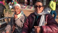 Portrati of senior female pilgrims take a rest in Boudhanath, Kathmandu, Nepal Stock Footage