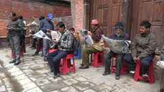Morning scene, reading newspapers on the streets in Kathmandu, Nepal Stock Footage
