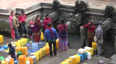 Ancient fountains, acquiring drinking water, queue, shortage, Kathmandu, Nepal Stock Footage