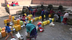 Water shortage, filling jerrycans, containers, poverty in Kathmandu, Nepal - stock footage